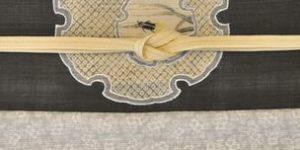 絽ちりめんの小紋を雪輪に蛍柄の帯でコーディネート