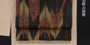 置賜紬に合わせた矢羽根柄の帯