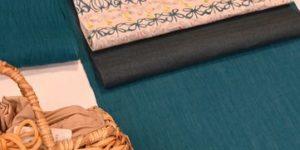 エメラルドグリーンの小千谷ちぢみを型絵染の麻帯でコーディネート